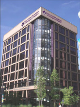 A rendering depicting the new signs for the International Academies of Emergency Dispatch on the former Deseret News building. The IAED purchased the property from the LDS Church.