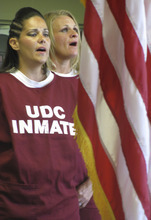 Nicki Mawhorter, left, and Stacy Westfahl were part of the choir that performed songs by Garth Brooks, Alicia Keys and LeeAnn Womack during a ceremony Wednesday for graduates of the ExCell program at the Timpanogos Women's Correctional Facility in Draper. Courtesy of Utah Department of Corrections.