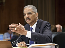 In this June 12, 2012 file photo, Attorney General Eric Holder testifies on Capitol Hill in Washington. In email exchanges with subordinates in February and March 2011, Attorney General Eric Holder and the department's second-highest official expressed growing concern that something might have gone wrong in a federal gun-smuggling probe called Operation Fast and Furious.  (AP Photo/J. Scott Applewhite)