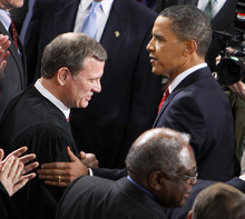 FILE - In this Jan. 27, 2010 file photo, President Barack Obama greets Chief Justice John Roberts before he delivered his State of the Union Address on Capitol Hill in Washington. Breaking with the court's other conservative justices, Roberts announced the judgment that allows the law to go forward with its aim of covering more than 30 million uninsured Americans. Roberts explained at length the court's view of the mandate as a valid exercise of Congress' authority to