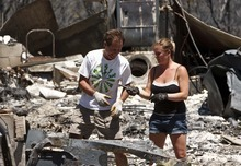 Leah Hogsten  |  The Salt Lake Tribune Amy Beattie and her father, Bruce Beattie, find some of his burnt tools in the charred remains of Bruce's home Friday, June 29, 2012 in New Harmony.