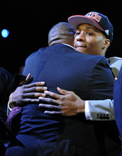 Damian Lillard, right, of Weber State, is hugged after being selected the No. 6 overall draft pick by the Portland Trail Blazers in the NBA basketball draft, Thursday, June, 28, 2012, in Newark, N.J. (AP Photo/Bill Kostroun)