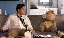 This film image released by Universal Pictures shows Mark Wahlberg, left with the character Ted, voiced by Seth MacFarlane in a scene from