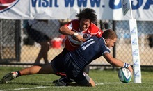 Kim Raff   The Salt Lake Tribune At the end of the half USA's Noah Tarrant dives into the try zone as Japan's Seiyu Kohara misses the tackle during the Junior World Rugby Trophy 2012 Final at Murray Rugby Park Stadium in Murray, Utah on June 30, 2012.