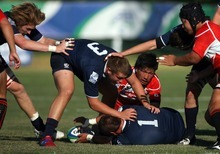 Kim Raff   The Salt Lake Tribune USA players (bottom) Travis Whitlock and (top) Henry Hall try and maintain control of the ball against Japan during the Junior World Rugby Trophy 2012 Final at Murray Rugby Park Stadium in Murray, Utah on June 30, 2012.