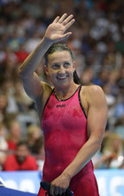 Rebecca Soni waves to the crowd after winning the women's 200-meter breaststroke final at the U.S. Olympic swimming trials, Saturday, June 30, 2012, in Omaha, Neb. (AP Photo/Mark J. Terrill)