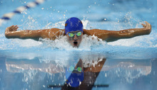 Ryan Lochte swims in the men's 200-meter individual medley final at the U.S. Olympic swimming trials on Saturday, June 30, 2012, in Omaha, Neb. Michael Phelps won the final. (AP Photo/Mark Humphrey)