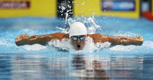 Ryan Lochte swims in the men's 100-meter butterfly preliminaries at the U.S. Olympic swimming trials on Saturday, June 30, 2012, in Omaha, Neb. (AP Photo/Mark Humphrey)