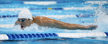 Michael Phelps swims in the men's 100-meter butterfly preliminaries at the U.S. Olympic swimming trials, Saturday, June 30, 2012, in Omaha, Neb. (AP Photo/Mark J. Terrill)