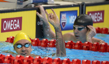 Anthony Ervin reacts after swimming in a men's 50-meter freestyle semifinal at the U.S. Olympic swimming trials, Saturday, June 30, 2012, in Omaha, Neb. (AP Photo/Mark J. Terrill)