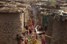 Pakistani children living in Islamabad's slums run in Pakistan, Wednesday, June 27, 2012. (AP Photo/B.K. Bangash)