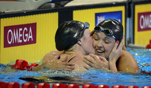 Missy Franklin, left, kisses Rachel Bootsma after winning the women's 100-meter backstroke final at the U.S. Olympic swimming trials, Wednesday, June 27, 2012, in Omaha, Neb. (AP Photo/Mark J. Terrill)