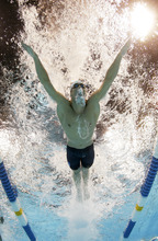 Michael Phelps swims to victory in the men's 200-meter butterfly final at the U.S. Olympic swimming trials, Thursday, June 28, 2012, in Omaha, Neb. (AP Photo/Mark J. Terrill)
