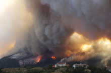 Fire from the Waldo Canyon wildfire burns as it moved into subdivisions and destroyed homes in Colorado Springs, Colo., on Tuesday, June 26, 2012. (AP Photo/Gaylon Wampler)