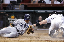 San Diego Padres' Alexi Amarista, left, is tagged out at home by Houston Astros' Chris Snyder in the ninth inning of a baseball game Wednesday, June 27, 2012, in Houston. The Astros won 1-0. (AP Photo/Pat Sullivan)