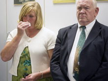 Kim Raff | The Salt Lake Tribune (left) Angela Rice and Robert Beesley, sister and father to Aaron Beesley, the UHP trooper who died during a search and rescue operation, stand during a press conference about Beesley's death at the UHP's section 3 office in Farmington, Utah on July 1, 2012.