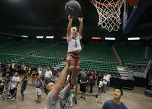 Scott Sommerdorf  |  The Salt Lake Tribune              Young Owen Wilson is lifted up by his father Matt Wilson of Salt Lake City during an NBA draft party for Utah Jazz fans at EnergySolutions Arena in Salt Lake City on Thursday, June 28, 2012.