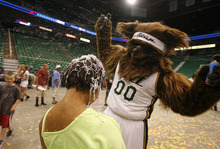 Scott Sommerdorf  |  The Salt Lake Tribune              The Jazz Bear doused Anastasia Scott with silly string as he fills time before the Jazz pick at #47, at least an hour later. The Utah Jazz held an NBA draft party for fans at EnergySolutions Arena, Thursday, June 28, 2012.
