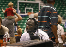 Scott Sommerdorf  |  The Salt Lake Tribune              Utah Jazz head coach Tyrone Corbin does a radio interview on the floor during an NBA draft party for fans at EnergySolutions Arena in Salt Lake City on Thursday, June 28, 2012.
