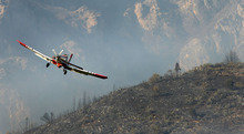 Steve Griffin | The Salt Lake Tribune A plane pulls up after dropping its payload of fire retardant as fire burns in the mountains near Alpine on Tuesday July 3, 2012.