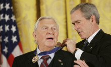 FILE - This Nov. 9, 2005 file photo shows President Bush presenting the Presidential Medal of Freedom to actor Andy Griffith in the East Room of the White House. Griffith, whose homespun mix of humor and wisdom made