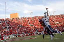 Tribune file photo Jonny Harline battles Eric Weddle as he snags a pass for BYU during a game at Rice-Eccles Stadium.