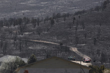 Scott Sommerdorf  |  The Salt Lake Tribune              Torched hillsides just off Rosecrest Drive in Herriman, Sunday, July 1, 2012.