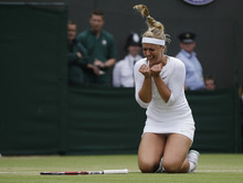 Sang Tan | The Associated Press Sabine Lisicki of Germany reacts winning against Maria Sharapova of Russia during a fourth round single match at the All England Lawn Tennis Championships at Wimbledon, England, Monday, July 2, 2012. (AP Photo/Sang Tan)