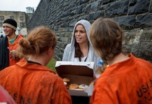 Trent Nelson  |  The Salt Lake Tribune Jennifer Carver passes out donuts to volunteers role playing as inmates at the Mock Prison Riot, Tuesday, May 8, 2012 at the West Virginia Penitentiary in Moundsville, West Virginia.