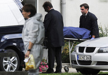 A body is moved from a house in Karlsruhe , Germany,  after  a hostage-taking Wednesday July 4, 2012.  Police commandos stormed an apartment in southern Germany on Wednesday after a hostage standoff and found five bodies, including that of the gunman, a spokesman said. Inside they found the bodies of the suspect, as well as those of the court bailiff who had sought to evict the man, the locksmith who had accompanied him, the woman who was supposed to take over the apartment and another person, he said.  The man opened fire when the bailiff and others went to his apartment at about 9 a.m. to eject him for failing to pay his rent, and then multiple shots were filed, killing one person.   (AP Photo/dapd/Daniel Kopatsch)