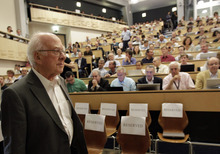 British physicist Peter Higgs arrives for a scientific seminar to deliver the latest update in the search for the Higgs boson at the European Organization for Nuclear Research (CERN) in Meyrin near Geneva, Switzerland, Wednesday, July 4, 2012. The head of the world's biggest atom smasher is claiming discovery of a new particle that he says is consistent with the long-sought Higgs boson known popularly as the