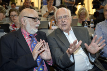 Belgian physicist Francois Englert, left, and British physicist Peter Higgs answers journalist's question about the scientific seminar to deliver the latest update in the search for the Higgs boson at the European Organization for Nuclear Research (CERN) in Meyrin near Geneva, Switzerland, Wednesday, July 4, 2012. The head of the world's biggest atom smasher is claiming discovery of a new particle that he says is consistent with the long-sought Higgs boson known popularly as the