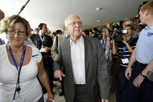 British physicist Peter Higgs arrives for a press conference about the latest update in the search for the Higgs boson at the European Organization for Nuclear Research (CERN) in Meyrin near Geneva, Switzerland, Wednesday, July 4, 2012. The head of the world's biggest atom smasher is claiming discovery of a new particle that he says is consistent with the long-sought Higgs boson known popularly as the