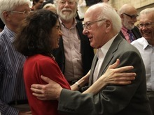 British physicist Peter Higgs, right, congratulates Fabiola Gianotti, ATLAS experiment spokesperson, after her results presentation during a scientific seminar to deliver the latest update in the search for the Higgs boson at the European Organization for Nuclear Research (CERN) in Meyrin near Geneva, Switzerland, Wednesday, July 4, 2012. The head of the world's biggest atom smasher is claiming discovery of a new particle that he says is consistent with the long-sought Higgs boson known popularly as the