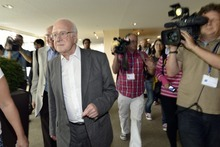 British physicist Peter Higgs, left, arrives to hear about the latest update in the search for the Higgs boson at the European Organization for Nuclear Research (CERN) in Meyrin near Geneva, Switzerland, Wednesday, July 4, 2012. The head of the world's biggest atom smasher is claiming discovery of a new particle that he says is consistent with the long-sought Higgs boson known popularly as the