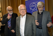 Belgian  physicist Francois Englert, left, Rolf Heuer, right, Director General of CERN (European Organization for Nuclear Research) and British physicist Peter Higgs, center, leave after the answers journalist's question at the European Organization for Nuclear Research (CERN) in Meyrin near Geneva, Switzerland, Wednesday, July 4, 2012.   Scientists at the world's biggest atom smasher claimed the discovery of a new subatomic particle Wednesday, calling it