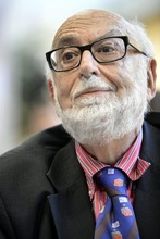 Belgian  physicist Francois Englert, answers journalist's question at the European Organization for Nuclear Research (CERN) in Meyrin near Geneva, Switzerland, Wednesday, July 4, 2012.   Scientists at the world's biggest atom smasher claimed the discovery of a new subatomic particle Wednesday, calling it