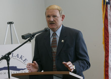 Rick Egan     Tribune file photo  The state forester, Dick Buehler, has been authorized to ban target shooting on a county-by-county basis outside of city limits. On Tuesday, Buehler expanded an existing ban on explosive targets, tracers and steel-jacketed ammunition anywhere in the state outside of city limits. Cities have the authority to impose their own restrictions. Buehler said Cache, Davis and Utah counties have asked him to ban all target shooting in areas where that practice has started fires.