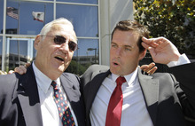 William Lynch reacts with his father John Lynch, left, outside of a San Jose, Calif., courthouse after William Lynch was found not guilty of two felonies, Thursday, July 5, 2012. Lynch was accused of beating an aging priest who Lynch says molested him and his younger brother more than 35 years ago.Lynch faced felony charges of assault and elder abuse. Prosecutors say he beat the Rev. Jerold Lindner at a retirement home for priests in 2010. (AP Photo/Paul Sakuma)