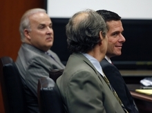 Will Lynch, center, reacts to the verdict in his trial in the courtroom of Santa Clara County Superior Court Judge David A. Cena, in San Jose, Calif., on Thursday, July 5, 2012. At left is his attorney Pat Harris, and co-counsel Paul A. Mones. Lynch was accused of beating an aging priest who Lynch says molested him and his younger brother more than 35 years ago. Lynch faced felony charges of assault and elder abuse. Prosecutors say he beat the Rev. Jerold Lindner at a retirement home for priests in 2010. (AP Photo/San Jose Mercury News, Karen T. Borchers, Pool)