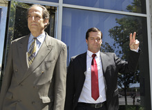 William Lynch, right, gives a victory sign as he walk outside of a San Jose, Calif., courthouse with his attorney Paul Mones, left, after he was found not guilty of two felonies, Thursday, July 5, 2012. Lynch was accused of beating an aging priest who Lynch says molested him and his younger brother more than 35 years ago.Lynch faced felony charges of assault and elder abuse. Prosecutors say he beat the Rev. Jerold Lindner at a retirement home for priests in 2010. (AP Photo/Paul Sakuma)