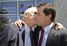 William Lynch, right, receives a kiss from his father John Lynch, left, outside of a San Jose, Calif., courthouse after William Lynch was found not guilty of two felonies, Thursday, July 5, 2012. Lynch was accused of beating an aging priest who Lynch says molested him and his younger brother more than 35 years ago.Lynch faced felony charges of assault and elder abuse. Prosecutors say he beat the Rev. Jerold Lindner at a retirement home for priests in 2010. (AP Photo/Paul Sakuma)