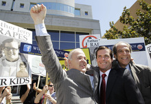 William Lynch, center, smiles with his attorneys Pat Harris, left, and Paul Mones, right, outside of a San Jose, Calif., courthouse after he was found not guilty of two felonies, Thursday, July 5, 2012. Lynch was accused of beating an aging priest who Lynch says molested him and his younger brother more than 35 years ago.Lynch faced felony charges of assault and elder abuse. Prosecutors say he beat the Rev. Jerold Lindner at a retirement home for priests in 2010. (AP Photo/Paul Sakuma)