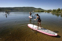 Rick Egan  | The Salt Lake Tribune   Rebecca Hale,11,  (right) paddles out into the water, along with her sisters, during their  stand up paddle boarding lesson at Jordanelle Reservoir, Thursday, June 14, 2012.