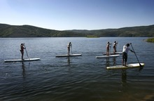 Rick Egan  | The Salt Lake Tribune   Trent Hickman (right) gives a lesson on stand up paddle boarding to the Hale sisters from Ft Lauderdale, Florida, at Jordanelle Reservoir, Thursday, June 14, 2012.