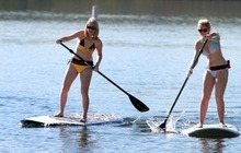 Rick Egan  | The Salt Lake Tribune   Sisters, Sarah Hale, 18, and Eva Hale, 14, from Ft Lauderdale, Florida, race each other to the shore on their stand up paddle boards at Jordanelle Reservoir, Thursday, June 14, 2012.