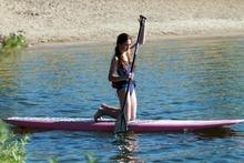 Rick Egan  | The Salt Lake Tribune   Rebecca Hale, 11,  paddles on her knees as she gets her balance, during a paddle boarding lesson at Jordanelle Reservoir, Thursday, June 14, 2012.