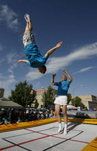 Francisco Kjolseth  |  The Salt Lake Tribune Members of Lowes Xtreme Airsports delight the crowds with a mobile trampoline as thousands line the streets of downtown Provo to watch the Freedom Festival Parade on Wednesday, July 4, 2012.