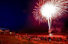 Spectators watch a fireworks show at the Flagler Pier in Flagler Beach, Fla., on Independence Day, Wednesday, July 4, 2012. (AP Photo/Daytona Beach News-Journal, David Massey)