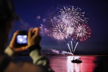 Allen Kiser of Robbinsdale, Minn., captures the fireworks over the Coquille River in Bandon, Ore. Kiser is an intern at Bandon Dunes Golf Resort for the summer. July 4, 2012 (AP Photo/Benjamin Brayfield, The World)